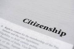 Medborgarskap som skrivs ut på boken med stora bokstäver royaltyfria foton