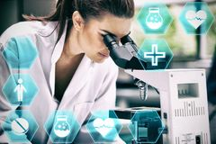 Composite image of medecine. Medecine against scientist looking into a microscope Royalty Free Stock Image