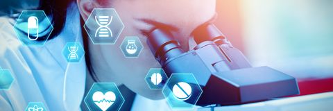Composite image of medecine. Medecine against young scientist using a microscope Stock Photos