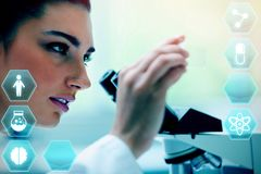 Composite image of medecine. Medecine against young woman looking at a microscope slide Stock Photos