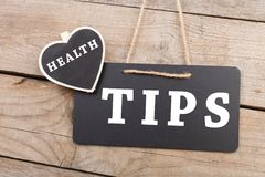 Medecine concept - blackboard with text `Health tips` royalty free stock photography