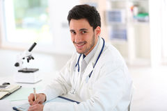 Medecine student analysing samples in lab Stock Images