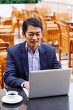 Medelålders asiatisk chef Royaltyfria Bilder