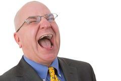 Medelålders skallig affärsman som ut högt skrattar Arkivbilder