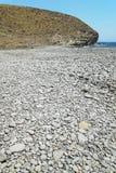 Medelhavs- Pebble Beach i Almeria, Andalusia, Spanien Arkivbilder