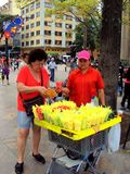 Medelin Colombia/19th November 2010/ A female tourists buys a po. Rtion of water melon from a street vendor in Plaza Botero Medelin Colombia royalty free stock images