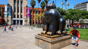 Medellin, Antioquia / Colombia - November 10 2015: Activity in the Botero Plaza. Sculpture Gato by Fernando Botero Stock Image