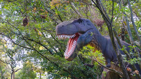 Medellin, Antioquia / Colombia - November 11 2015: Sculpture Tyrannosaurus Rex with a background of trees in an amusement park Stock Photo