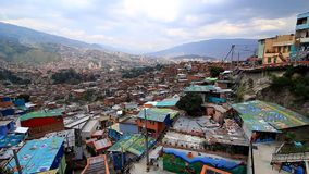Medellin, Colombia: a view from top of outdoor electrical escalators in the neighborhood of `Comuna 13`. Medellin, Colombia - April 2014: a view from top of stock footage
