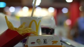 Medellin Colombia, October 17/2018. Hamburger, potatoes, soda and ice cream in McDonald`s restaurant stock video