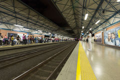 Medellin metro station with railway tracks and people, Colombia. Interior of the Medellin metro station with railway tracks and passengers waiting the next metro stock image