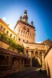 Medeltida gammal stad med klockatornet Arkivbild