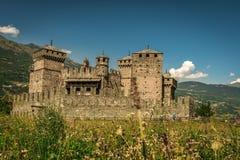 Medeltida historisk slott i staden av aostaen royaltyfri bild