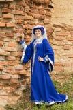 medeltida kvinna för härlig klänning royaltyfria bilder