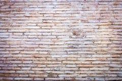 Medeltida roman bakgrund för tegelstenvägg Travertinestentegelstenar i naturlig färg Arkivfoto