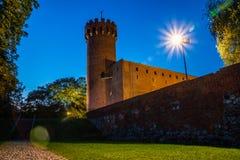 Medeltida Teutonic slott i Swiecie på natten Fotografering för Bildbyråer
