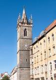 Medeltida torn med en klocka Royaltyfria Bilder