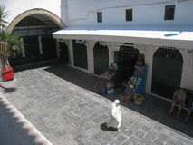 Mosque Es Zitouna street. Tunis. Tunisia. Medersa es Zitouna street, in the souk. Woman passing by the entrance to the mosque .Tunis. Tunisia Stock Photos