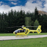 Medevac Helicopter. Air Ambulance medevac helicopter sitting on a helipad royalty free stock image