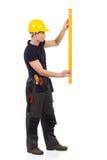 Medição do trabalhador manual Fotografia de Stock