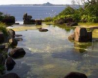 Mediação pelas águas tranquilos Imagem de Stock Royalty Free