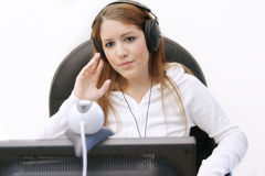 Media 2. Woman online listening to music stock photo