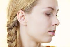 Media cara de la mujer con el pelo de la trenza Imagen de archivo libre de regalías