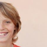 Media cara del niño sonriente feliz del muchacho Imagen de archivo