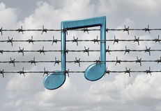 Media Censorship. Concept and music restriction symbol as a musical note on a barb or barbed wire fence element as a metaphor for parental control or banning Stock Photos
