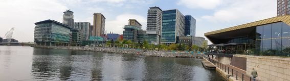 Media City UK television and radio broadcast centre on the banks of the Manchester Ship Canal in Salford and Trafford, Greater. Manchester, United Kingdom royalty free stock photo
