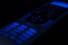 Media concept. Close up of a remote control with lights Royalty Free Stock Images
