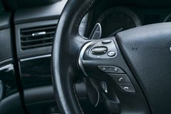 Media control buttons on the steering wheel in black perforatedMedia control buttons on the steering wheel in black perforated. Media control buttons on the Stock Image