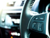 Media Controller Button at Steering Wheel stock photography