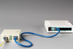Media converter with optical patchcord and router connected via copper cable Royalty Free Stock Image