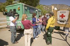 Media crews and forest service personnel Royalty Free Stock Photos