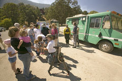 Media crews and forest service personnel Stock Photos