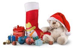 Media de la Navidad con los pequeños presentes y peluche Foto de archivo