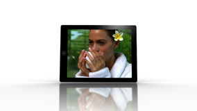 Media device screens showing spa scenes stock footage