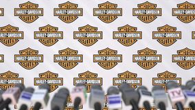 Media event of Harley-Davidson, press wall with logo and microphones, editorial animation stock video