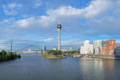 Media Harbor in Dusseldorf with Rheinturm TV tower, Germany Stock Photos