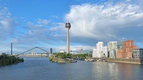 Media Harbor in Dusseldorf with Rheinturm TV tower, Germany Stock Photo