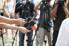 Media interview. TV or radio reporters interview Stock Images