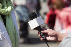 Media interview. With the microphone Royalty Free Stock Photo