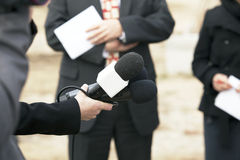 Media interview. With the microphone Royalty Free Stock Image