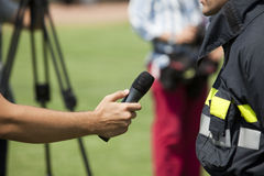 Media interview. An interview with a firefighter Royalty Free Stock Photos