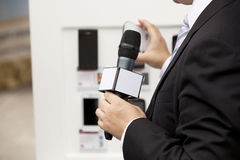 Media interview. With the microphone Royalty Free Stock Photography