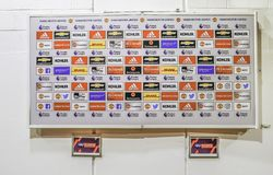 Media interview area at the Manchester United football club, white advertisement board