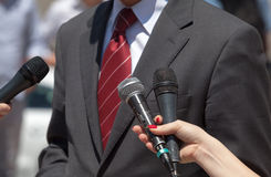 Media interview. Broadcast journalism. Journalists making interview with businessperson or politician Stock Photos