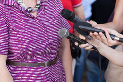 Media interview. Broadcast journalism. Reporters take media interview at news conference Royalty Free Stock Image