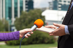 Media interview. Female reporter or journalist making media interview with businessman Stock Image